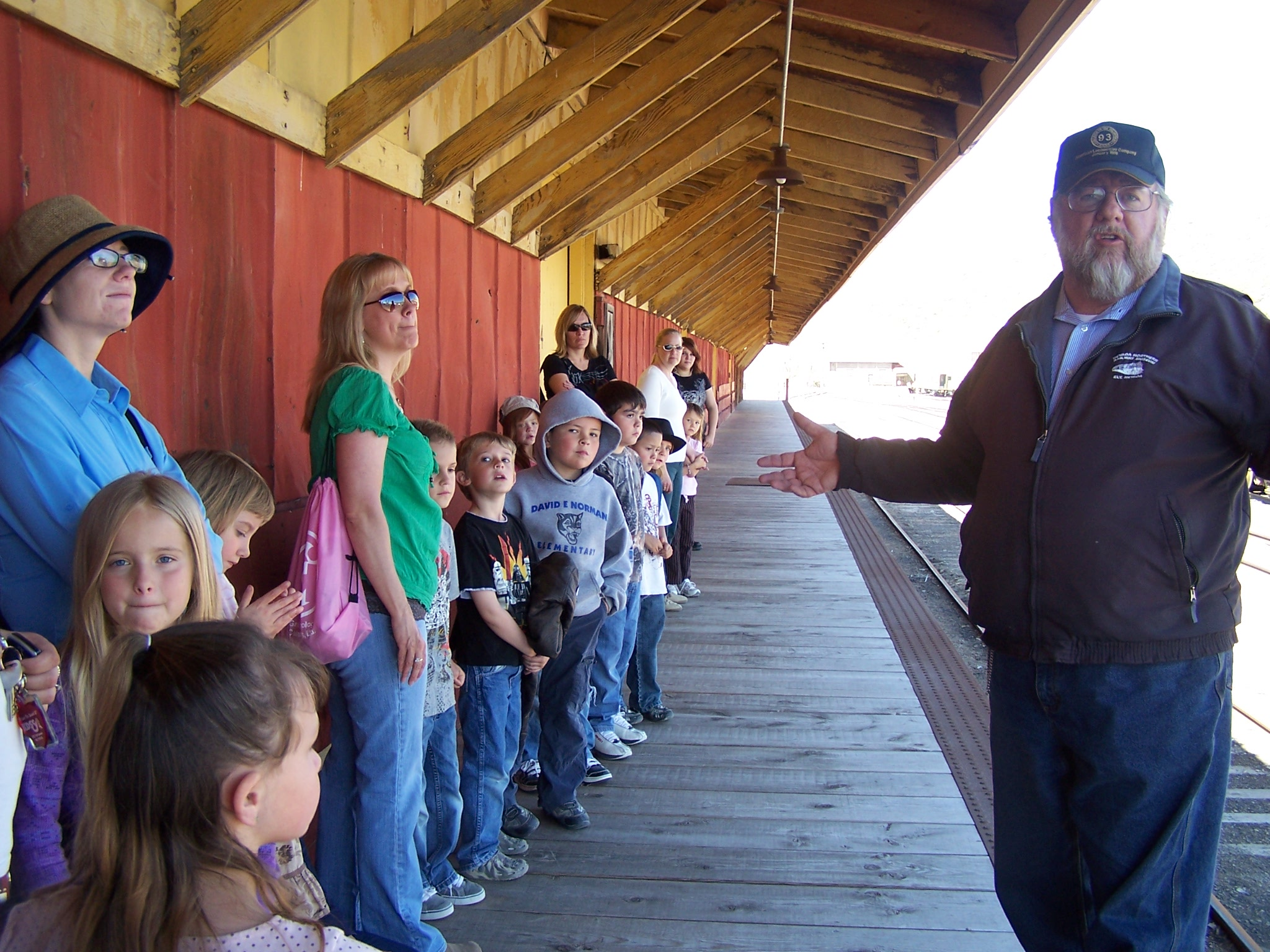 School group learning about what takes place in a rail yard