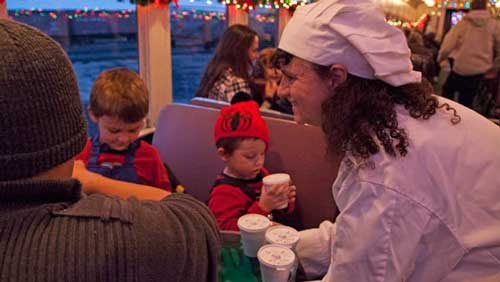 Santas Helpers serving sweet treats to passengers on the Christmas Train